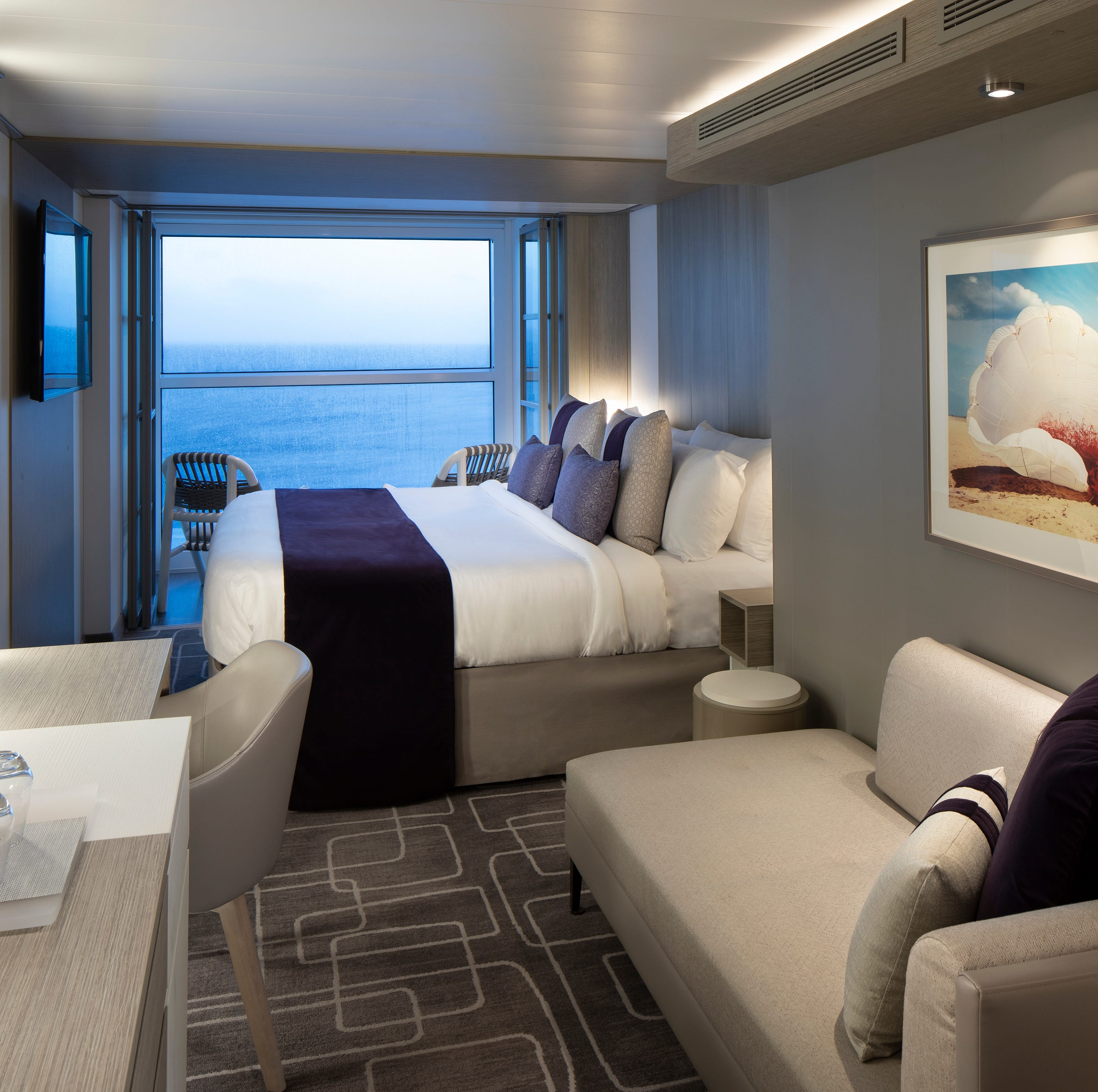 The Edge Stateroom with Infinite Veranda cabins on Celebrity Edge feature wall-to-wall, floor-to-ceiling glass that opens from the top down to create a balcony effect.