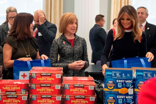 First lady Melania Trump helps assemble care packages for U.S. troops stationed abroad with Red Cross CEO Gail McGovern (C) and second lady Karen Pence (L) at the American Red Cross headquarters in Washington, DC, on Nov. 27, 2018.