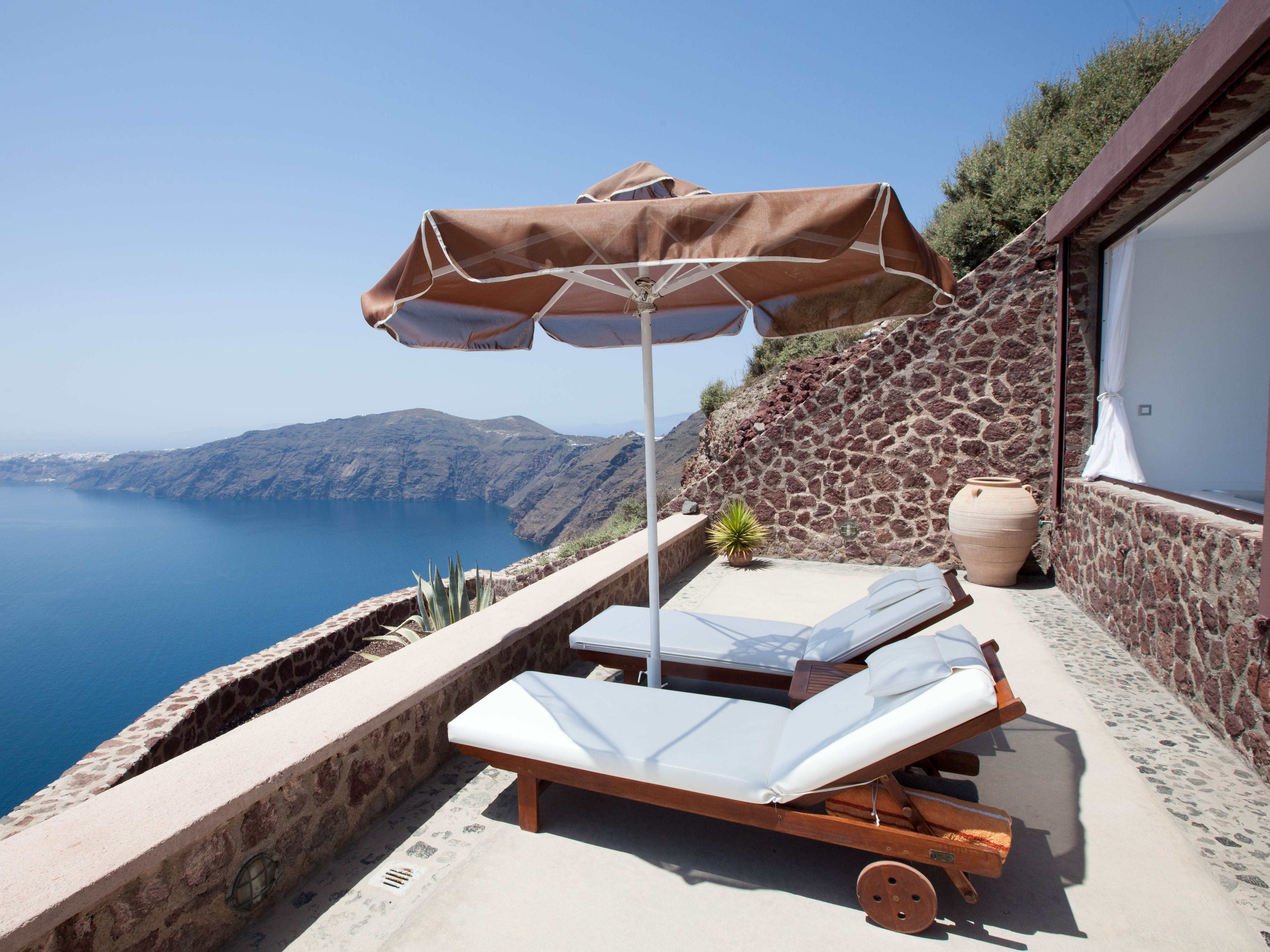 Anastasis Apartments: Located along the Imerovigli cliffs, Anastasis Apartments has many of the same trimmings of other Santorini hotels – iconic Cycladic architecture, a lovely infinity pool with out-of-this-world views, and large apartments with private balconies and kitchenettes. However, it stands out for what it lacks: steep steps, making it great for anyone with mobility issues. Bonus: It's within walking distance of bars and restaurants, but leave time to soak in the property, including the romantic cave-like spa.