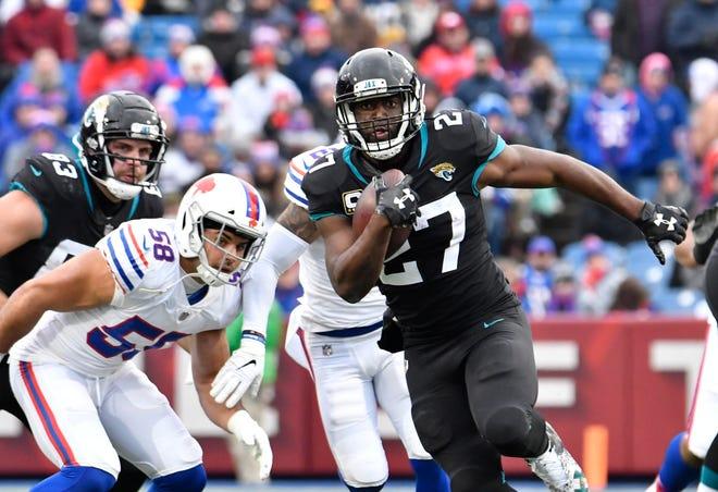 Jacksonville Jaguars running back Leonard Fournette (27) runs past Buffalo Bills outside linebacker Matt Milano (58) during the second quarter at New Era Field.