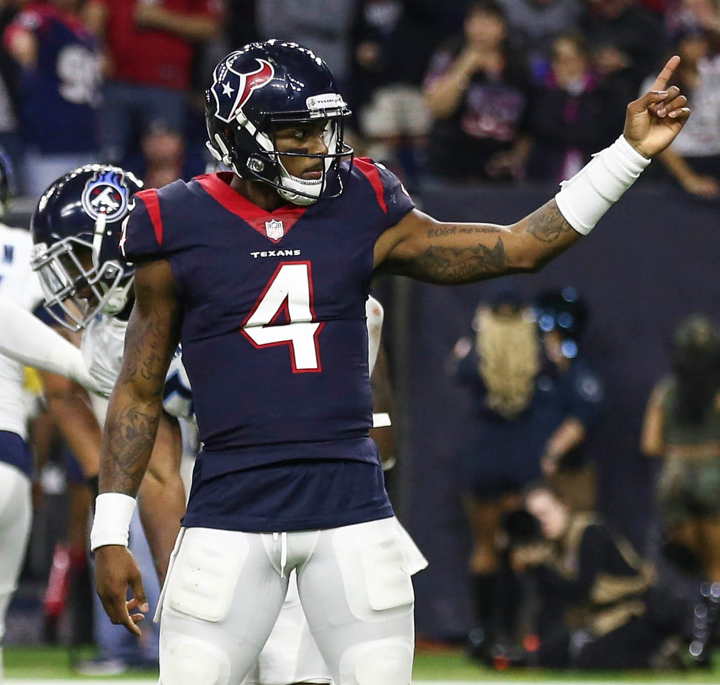 Houston Texans quarterback Deshaun Watson motions for a first down during the fourth quarter against the Tennessee Titans at NRG Stadium.