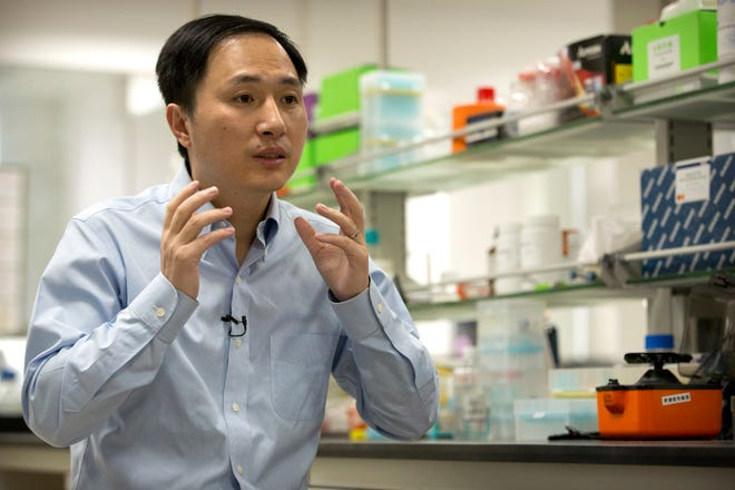 In this Oct. 10 photo, He Jiankui speaks during an interview at a laboratory in Shenzhen in southern China's Guangdong province. Chinese scientist He claims he helped make world's first genetically edited babies: twin girls whose DNA he said he altered.