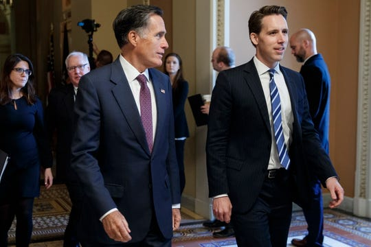 Republican senator-elect from Utah Mitt Romney, left, walks with Republican senator-elect from Missouri Josh Hawley, right, after the GOP leadership elections in the U.S. Capitol in Washington, D.C., Nov. 14, 2018.