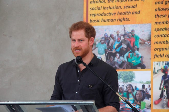 Prince Harry delivers a speech as he attends an event on Nov. 27, 2018 at Zambia Circus in Lusaka, Zambia.
