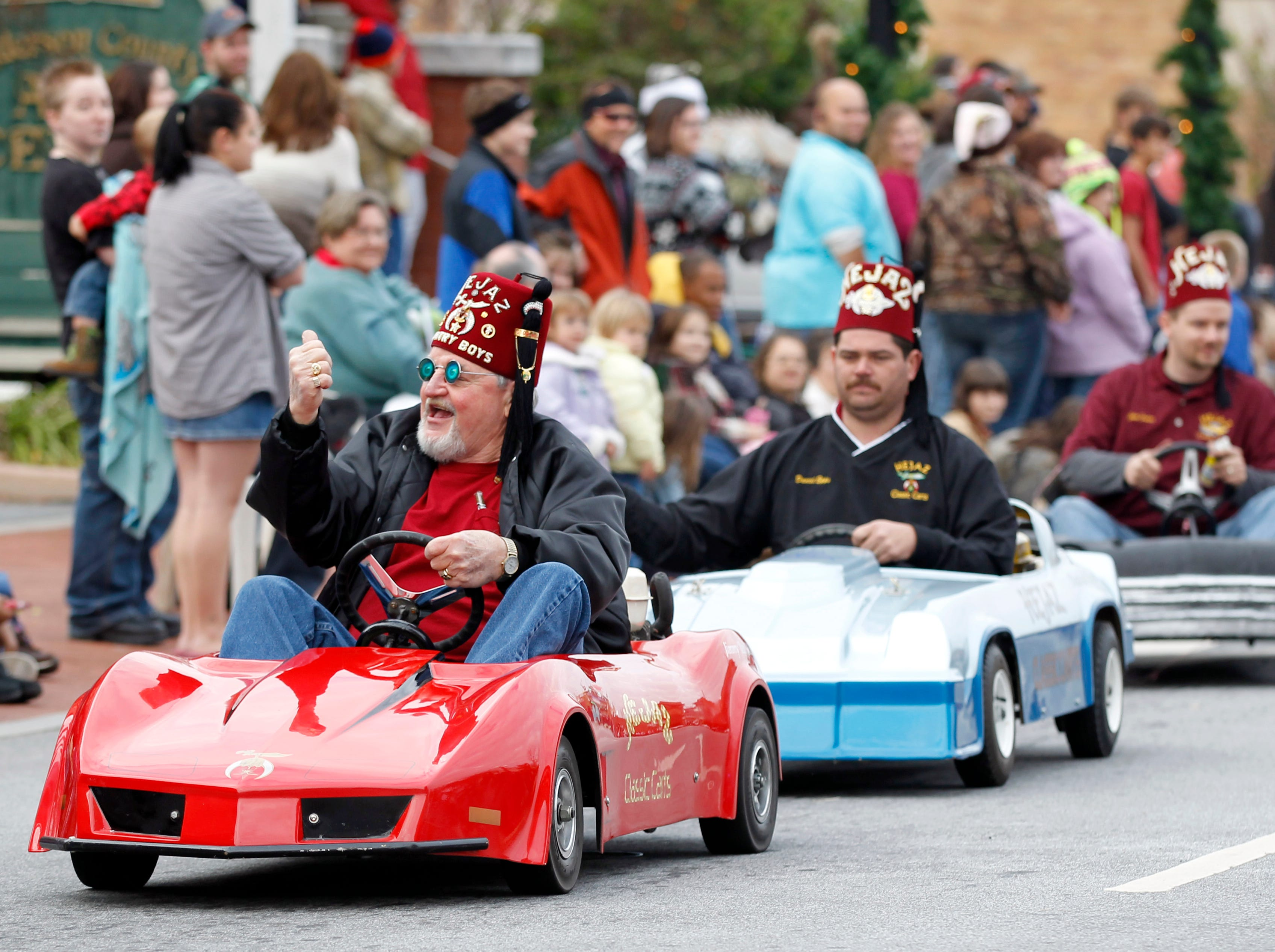 Hejaz Shriners ride miniature cars along Main Street during Sunday's Christmas parade in Anderson in 2011.