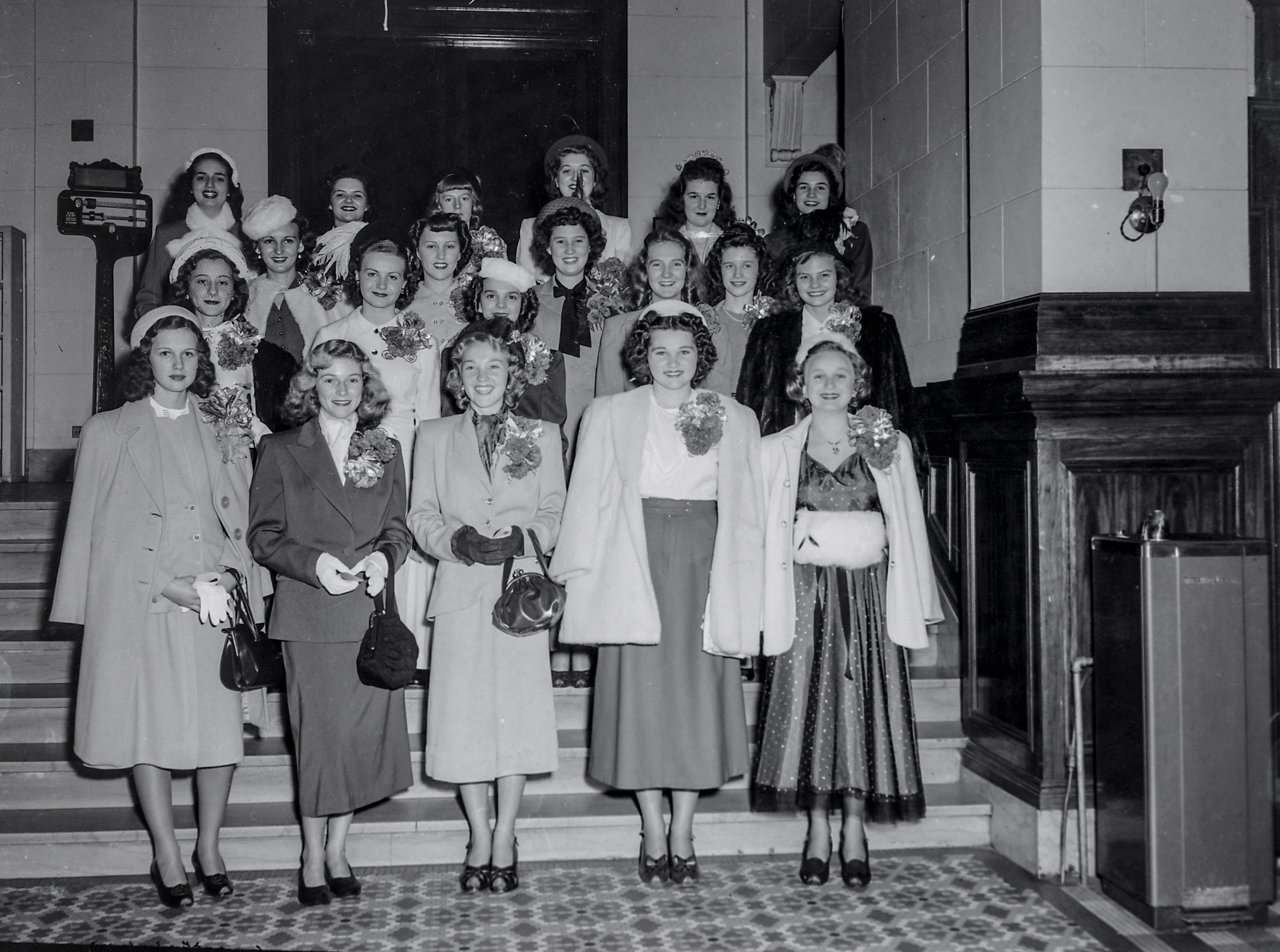 A group photograph of the beauty queens from various high schools in the area, taken at the Calhoun Hotel before the Anderson Christmas Parade on December 1949 in downtown Anderson.