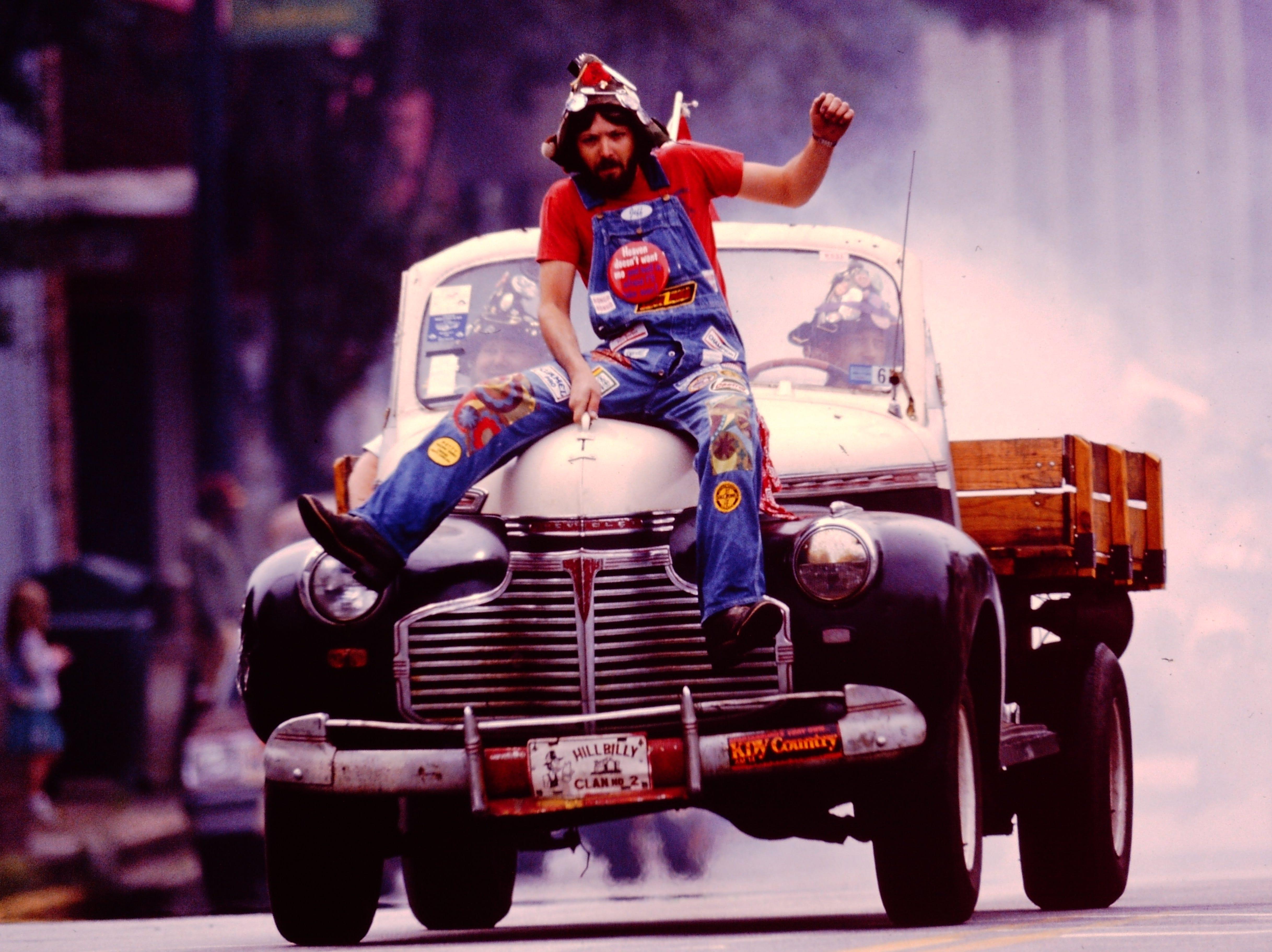 A man sitting on the hood of a pickup truck in the Anderson Christmas Parade in 1988.