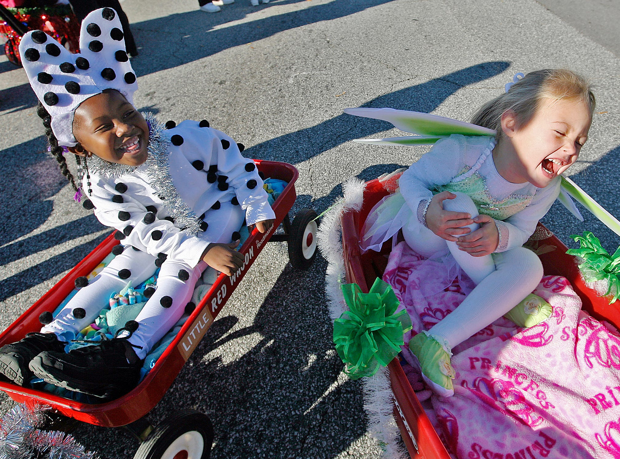 Makaila Lomax and Annsley Lowery laugh together before taking part in the Anderson Christmas Parade in 2002. The girls were part of a group of dancers from Steppin' Out Dance Studio, all of whom were dressed as Disney characters.