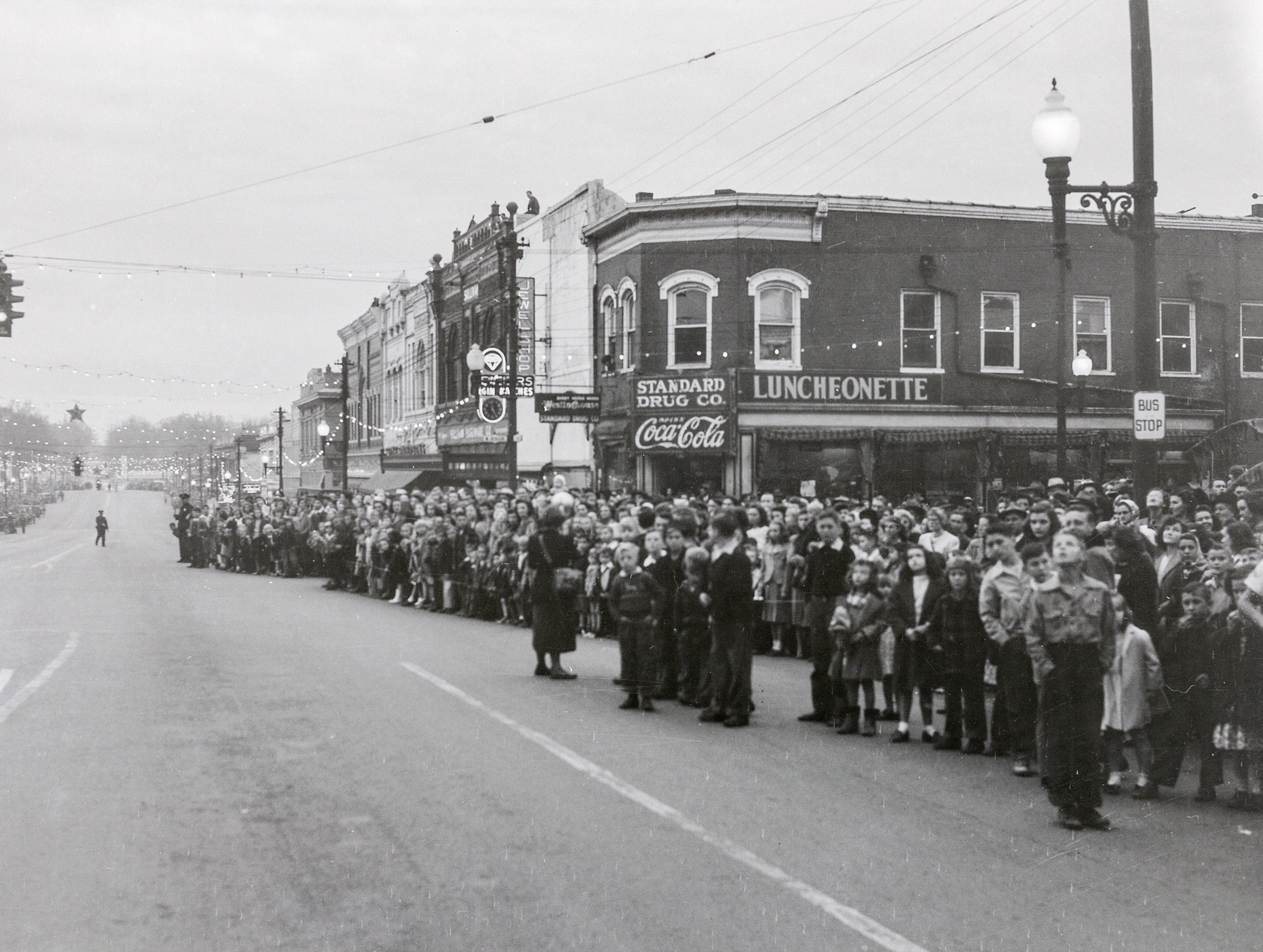 People line the sides of Main Street for the Anderson Christmas Parade on December 1949 in downtown Anderson.