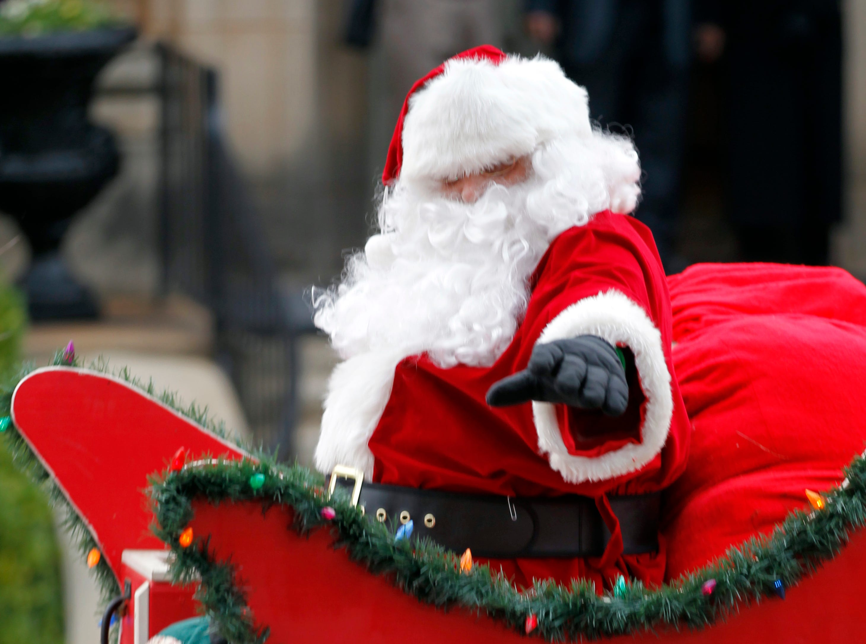Santa Claus arrives in downtown Anderson at the rear of Sunday's Christmas parade in 2011.