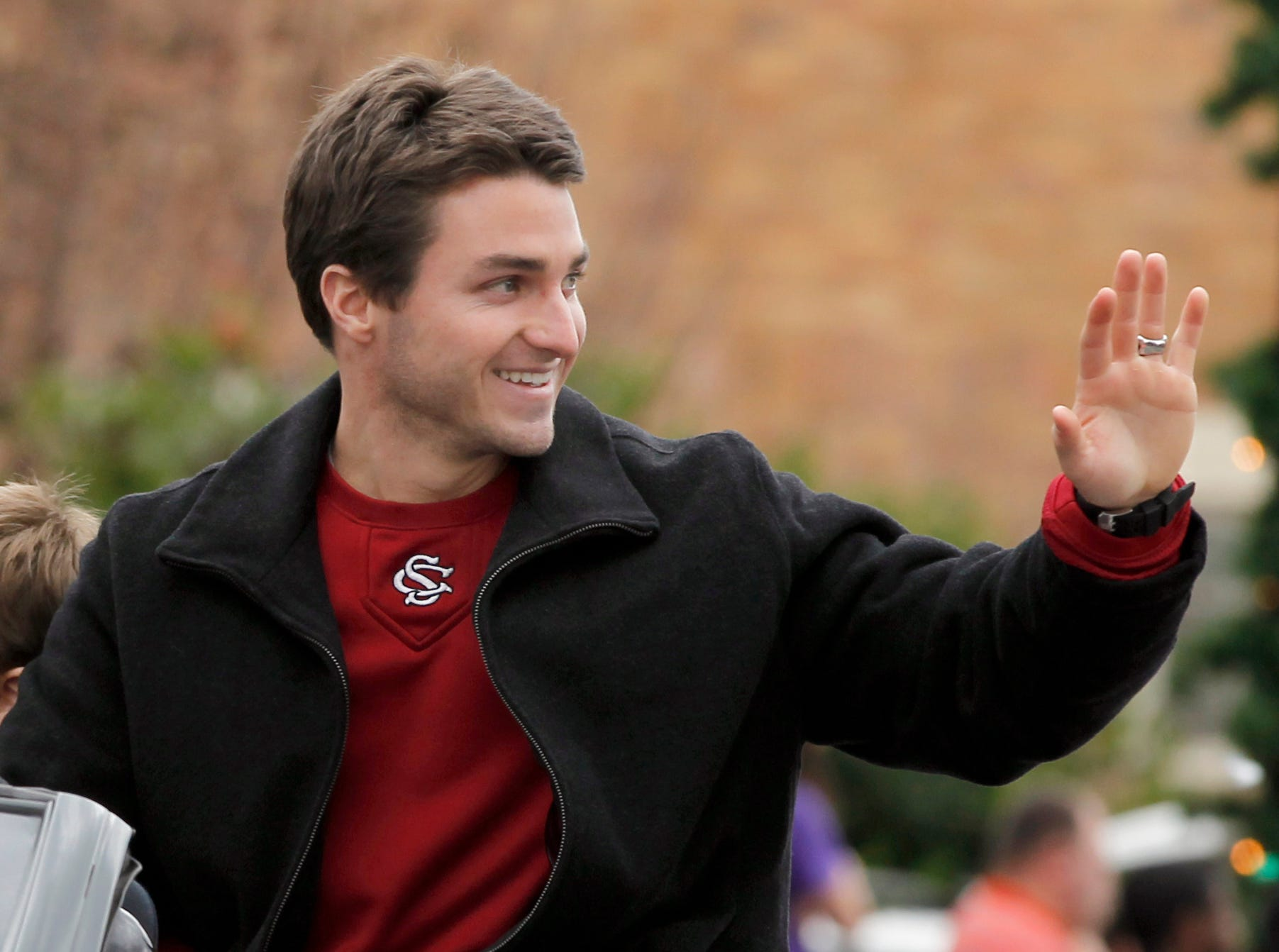 Parade Marshall Brady Thomas waves to the crowd during Sunday's Christmas parade in downtown Anderson in 2011. Thomas, an Anderson native, was a member of the University of South Carolina national champion baseball teams.