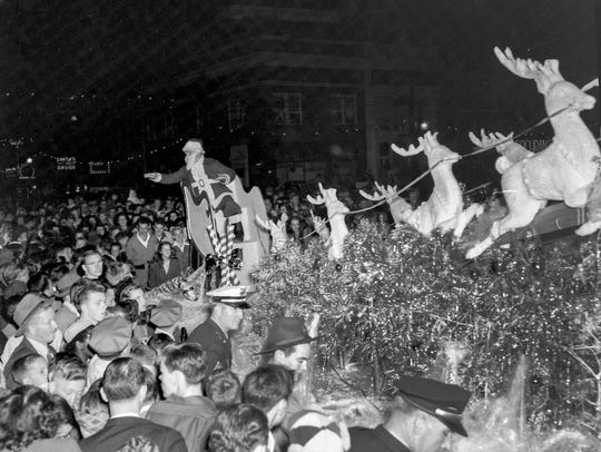 Santa Claus with reindeer at the Anderson Christmas Parade on December 1949 in downtown Anderson.
