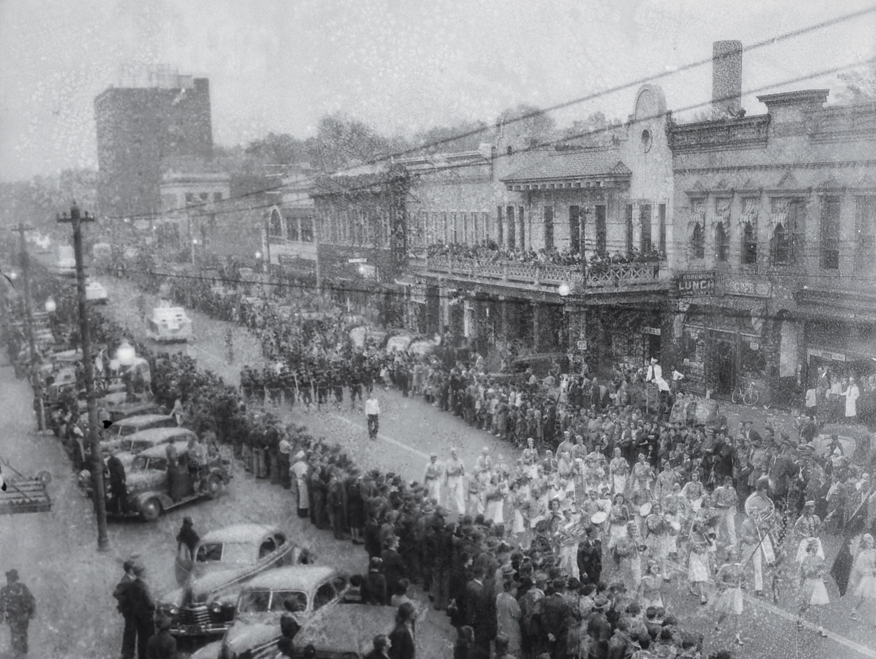 Cars line Main Street for the Anderson Christmas Parade in December 1942 in downtown Anderson.