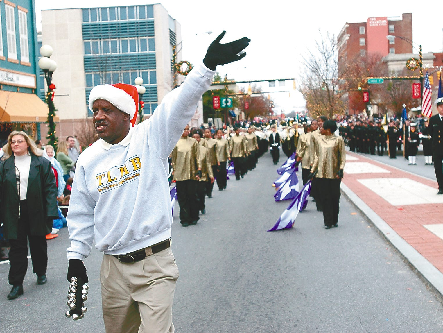 """James """"Radio"""" Kennedy leads the T.L. Hanna High School marching band in the 2002 Anderson Christmas parade."""