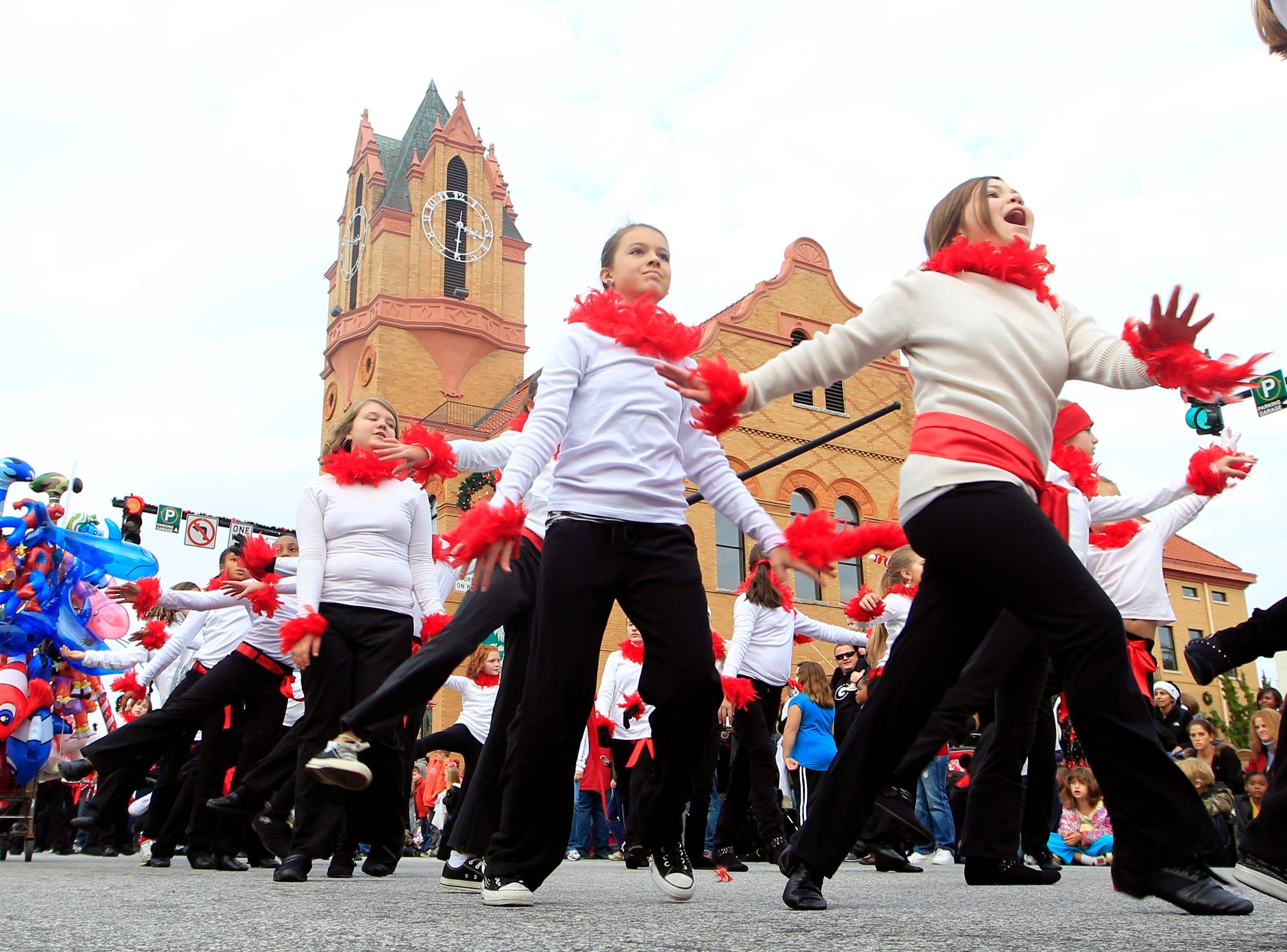Dancers perform a routine on the downtown square during the Anderson Christmas parade in 2011.