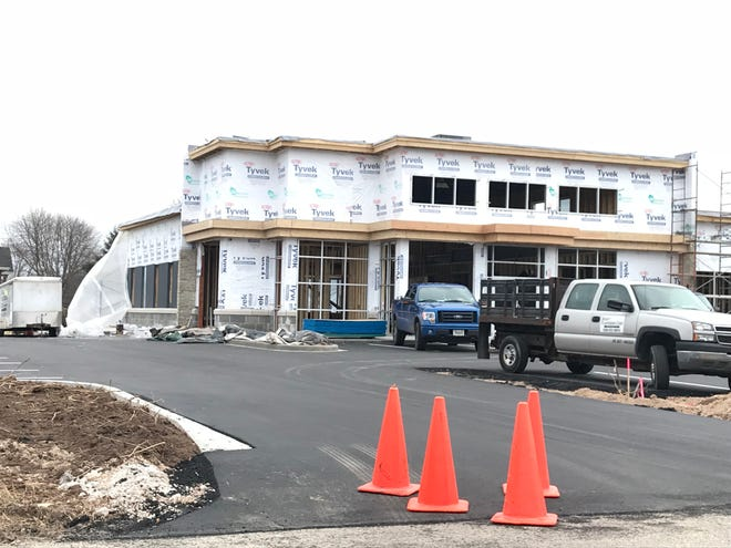 A new strip mall is under construction northeast of the Richmond Street/Northland Avenue roundabout.