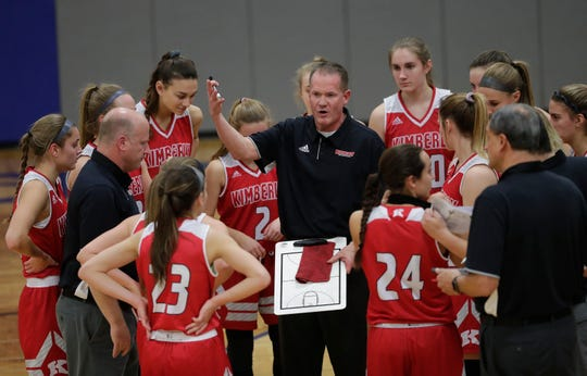 Kimberly coach Troy Cullen talks to his players during a timeout against Appleton West during their girls basketball game Nov. 27 in Appleton.
