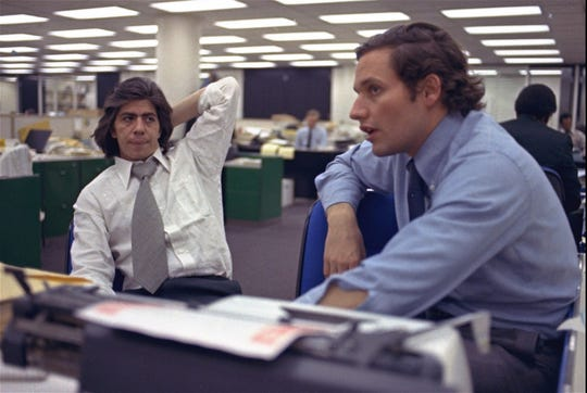 Reporters Bob Woodward, right, and Carl Bernstein, whose reporting of the Watergate case won a Pulitzer Prize, sit in the newsroom of the Washington Post, May 7, 1973.