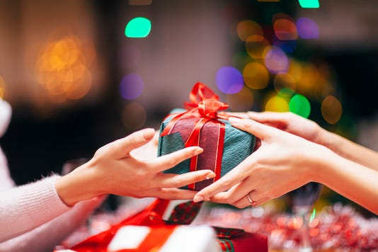Hands Giving Gift Close Up