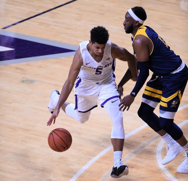 ACU's Payton Ricks (5) dribbles around Howard Payne's Javaris Jones (13) during Tuesday's game at Moody Coliseum in Abilene.