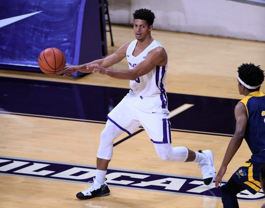 ACU's Payten Ricks (5) makes a pass during Tuesday's game against Howard Payne at Moody Coliseum in Abilene.