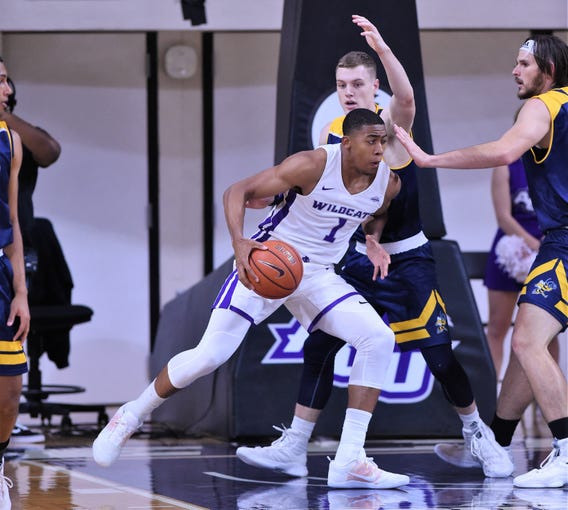 ACU's Jaren Lewis (1) backs down a Howard Payne defender in the lane during Tuesday night's game at Moody Coliseum.