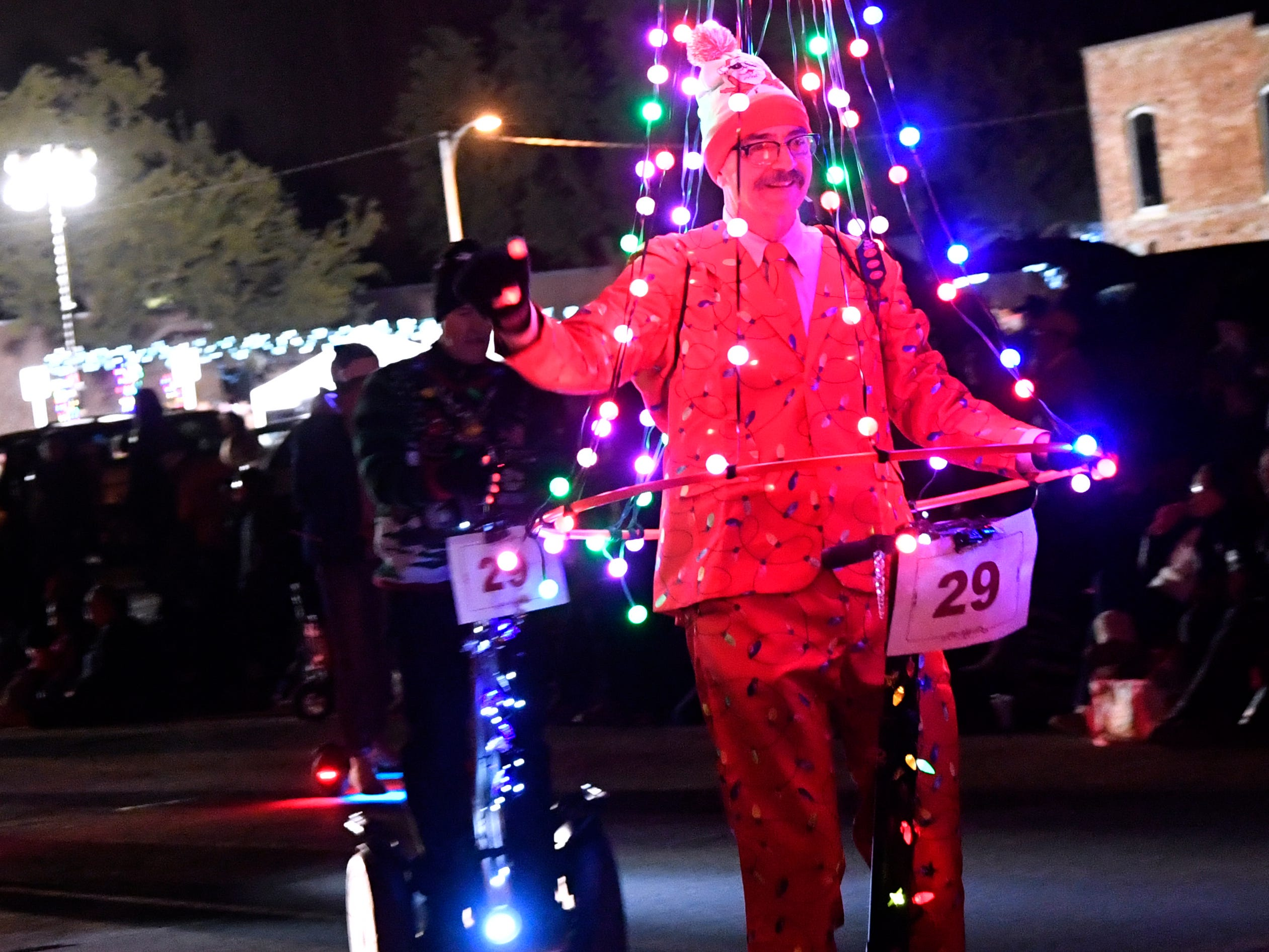 A Segway Christmas tree rolls down Cypress St. during Tuesday's parade Nov. 27, 2018. This was the 30th year for the City Sidewalks Christmas Lights Parade.