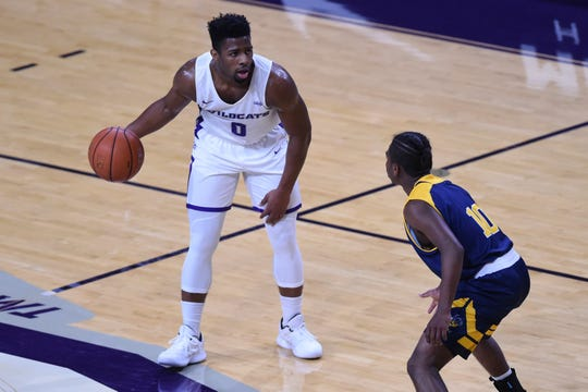 ACU's Jaylen Franklin (0) holds the ball near midcourt while defended by Howard Payne's Alex Mata (10) during Tuesday's game at Moody Coliseum in Abilene.