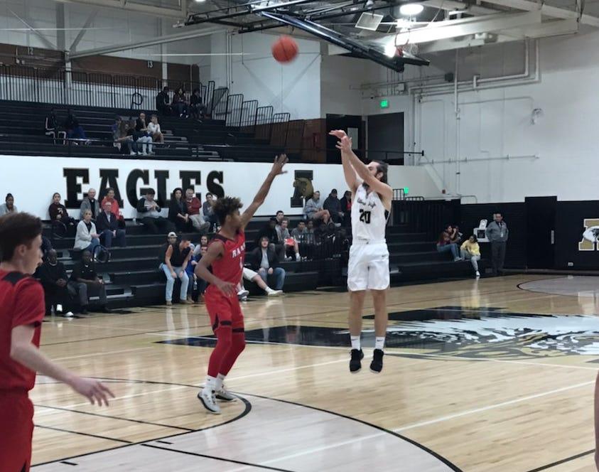 Brian Patton (20) shoots a three during Abilene High's non-district game against Mineral Wells Tuesday Nov. 27, 2018.