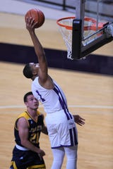 ACU's Jaren Lewis (1) goes up for a dunk during Tuesday's game against Howard Payne at Moody Coliseum in Abilene.