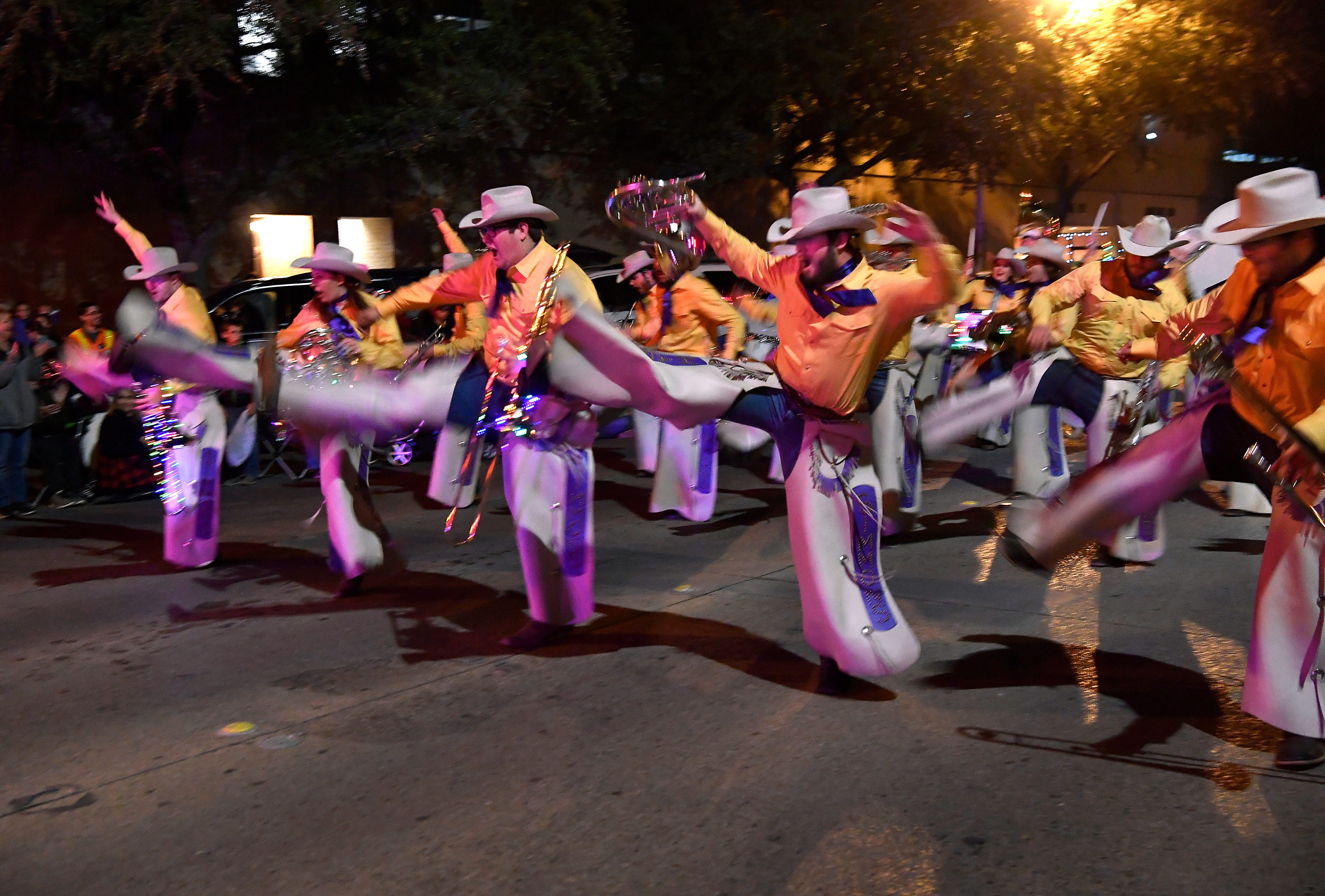 """In this file photo, the Hardin-Simmons University Cowboy Band performs their signature """"Cow Step"""" during the City Sidewalks Christmas Lights Parade on Nov. 27. The band is enjoying a wave of new membership under Director Bill Harden, HSU President Eric Bruntmyer said."""