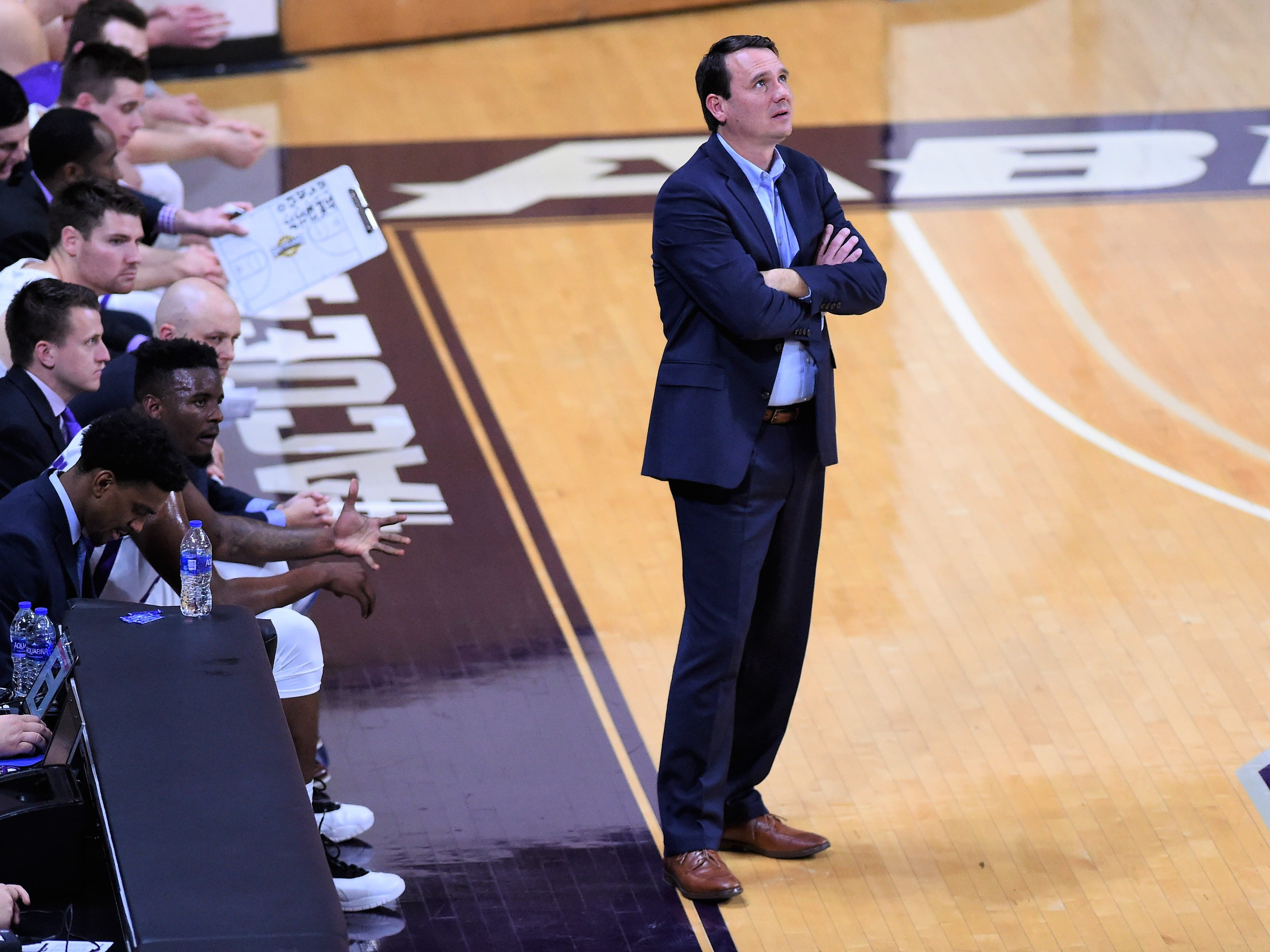 ACU head coach Joe Golding looks up at the scoreboard during Tuesday's game against Howard Payne at Moody Coliseum in Abilene.