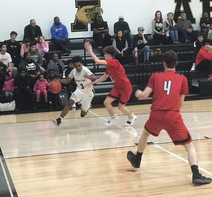 Jalen McGee drives baseline during Abilene High's non-district game against Mineral Wells Tuesday, Nov. 27, 2018.