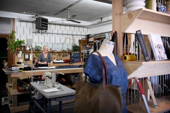 Meri Hannon works in Night Heron Studio. It is located in a building on Haywood Road in West Asheville that would be torn down under the proposed plan to expand I-240 nearby as part of the I-26 Connector project.