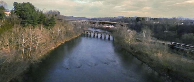 This simulation done for the state Department of Transportation is designed to show what a new crossing of the French Broad River planned as part of the I-26 Connector will look like as seen from Bowen Bridge.