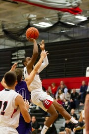 Marshall's Thailan Taylor takes a shot in the lane during the Redhawks win over Lakeview.