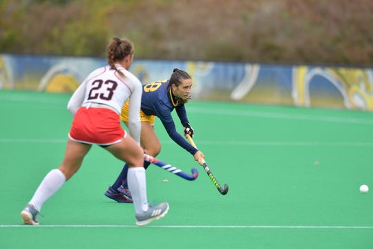 Kent State's Hailie Balachick (Windsor), right, had four goals and one assist in 2018.
