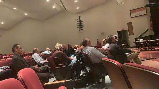 The crowd at the public hearing was board members and plan partners, in majority.