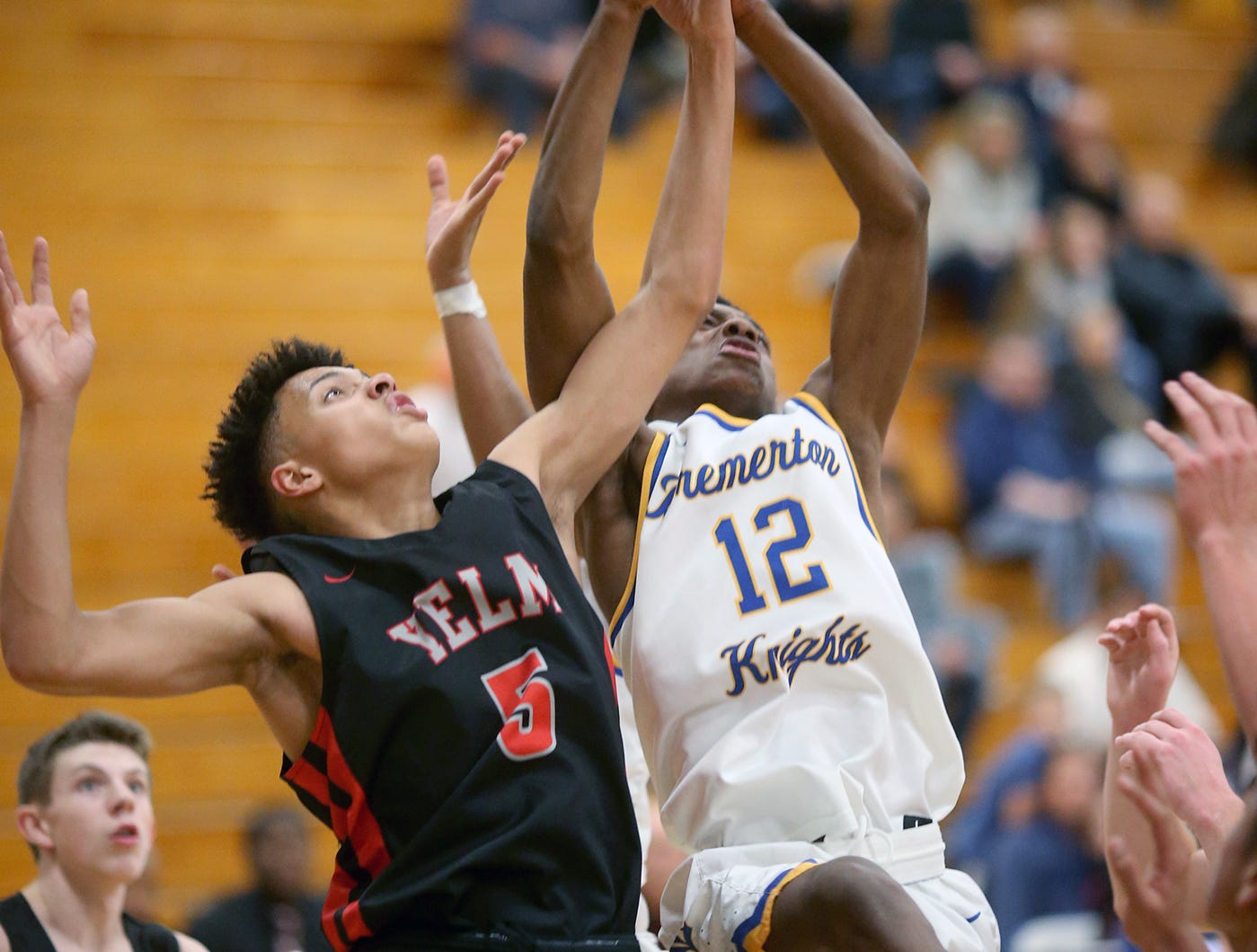 Bremerton played a boys basketball game against Yelm at Bremerton on Tuesday, November 27, 2018. Bremerton's Kanye Taylor fights for a rebound with Yelm's Tristan Pyette.