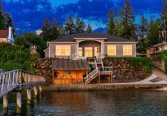 A western-facing waterfront home complete with a boat launch and a long deep-water dock sold in West Bremerton for$1.5 million in June.