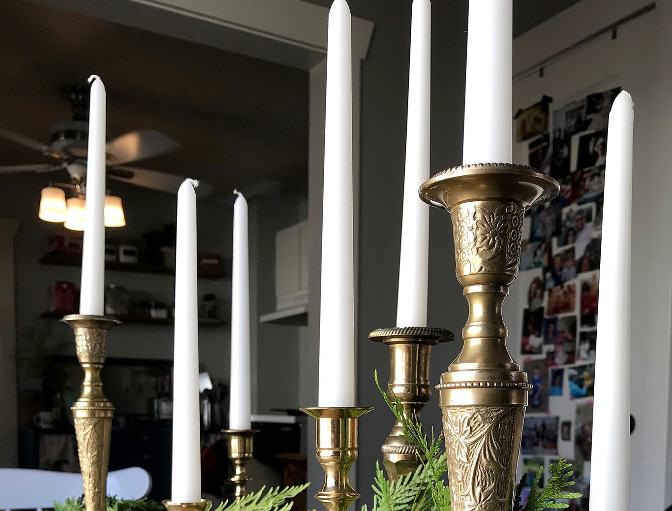 Garland spread among brass candlesticks makes for an easy dining room centerpiece.
