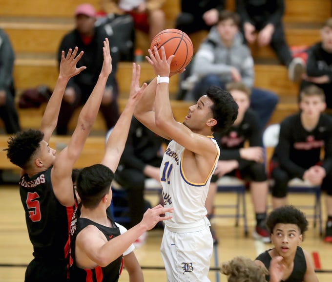 Bremerton played a boys basketball game against Yelm at Bremerton on Tuesday, November 27, 2018. Bremerton's Keoni Laguana puts up a shot.