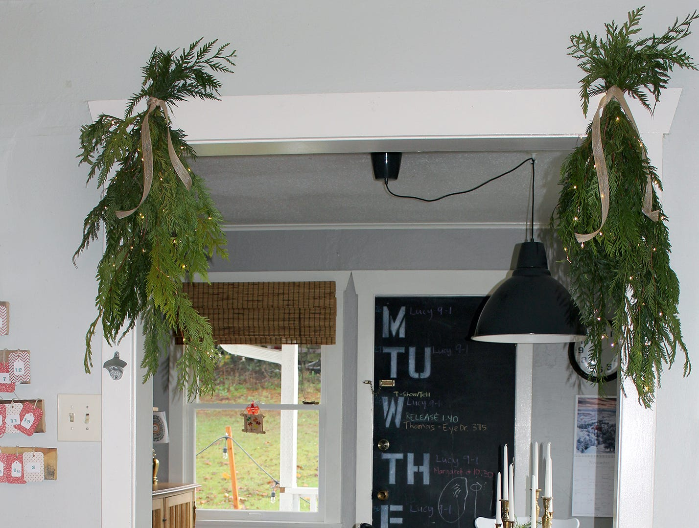 Swags of garland decorate the entryway into the dining area.