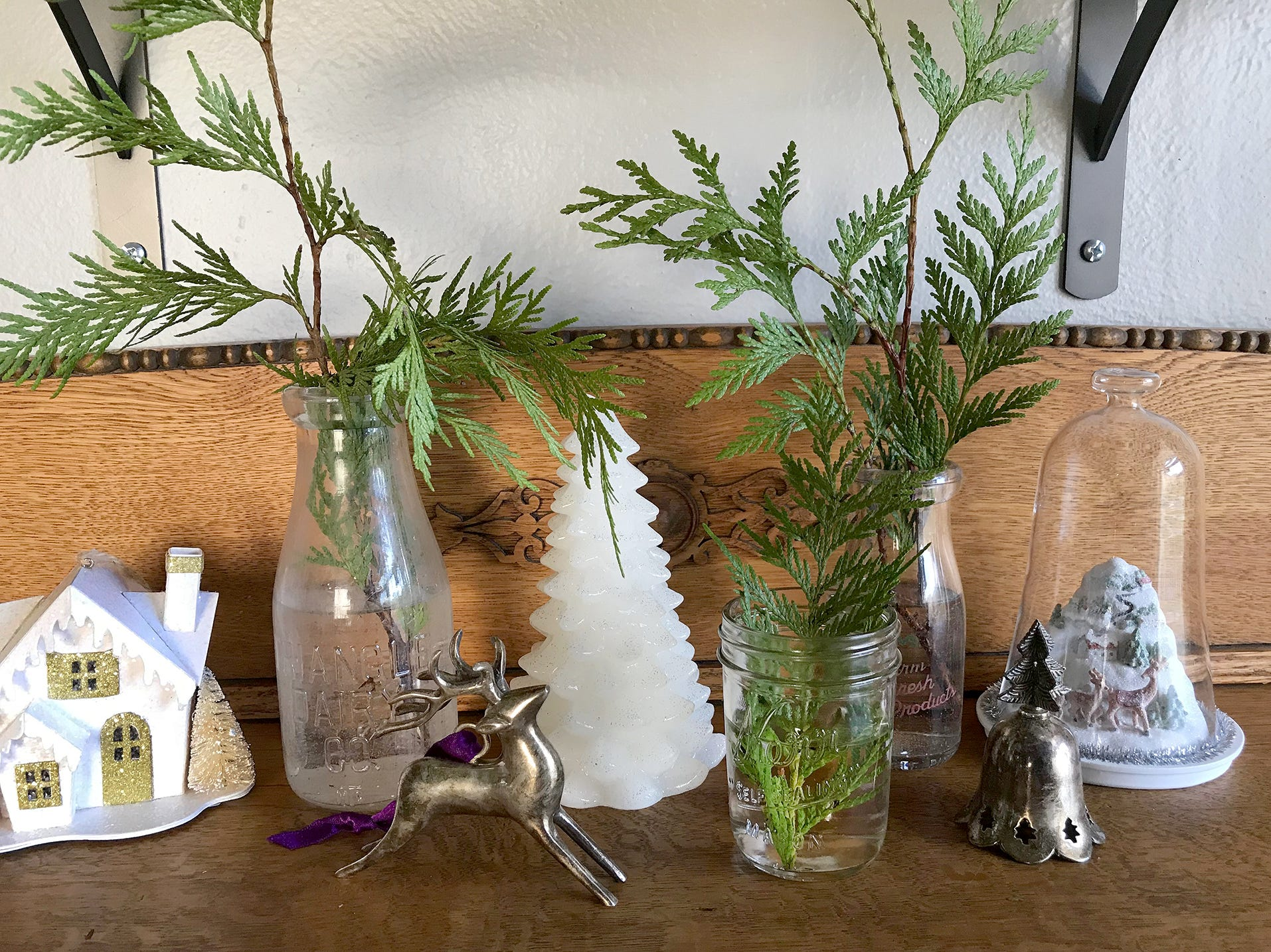 Some sprigs of garland in vases bring a fresh element to vintage decorations.