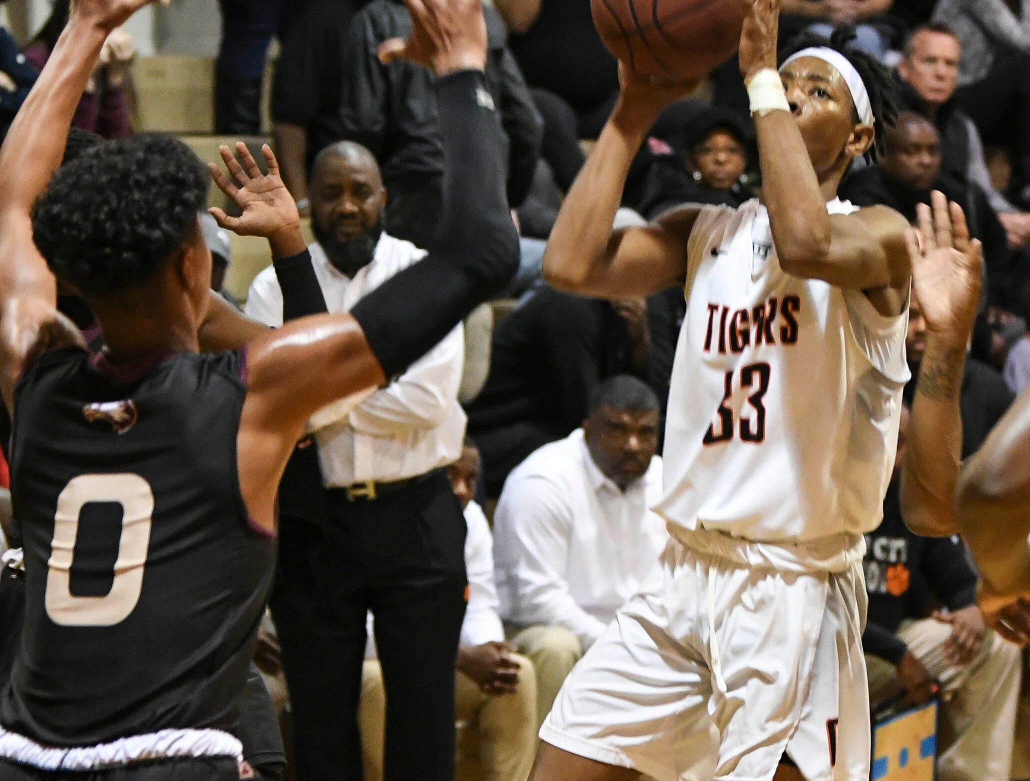 J Robinson of Cocoa shoots and scores during Tuesday's game against Astronaut.