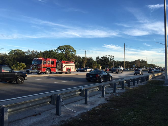Melbourne fire crews wash roadway after cement spill slows down northbound lanes of U.S. 1 near Post Road.