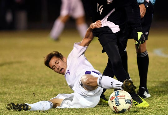 Mario Licor of Space Coast tries to tackle the ball away from Luis Esteban Son of Rockledge during a game at McLarty Stadium.