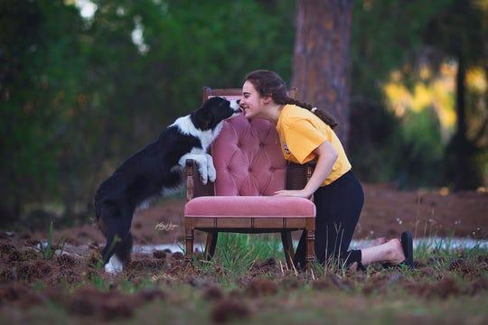 Emma Pitstick poses with border collie Zuko.