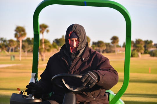 The temperatures dipped into the 30s on the Space Coast on Nov. 28, 2018, bringing the first real chill of the season to Brevard. Beachside the temperatures hit the low 40s and Craig Francis with the grounds crew at the Cocoa Beach Golf Course was bundled up to mow the greens, starting at 5 a.m.