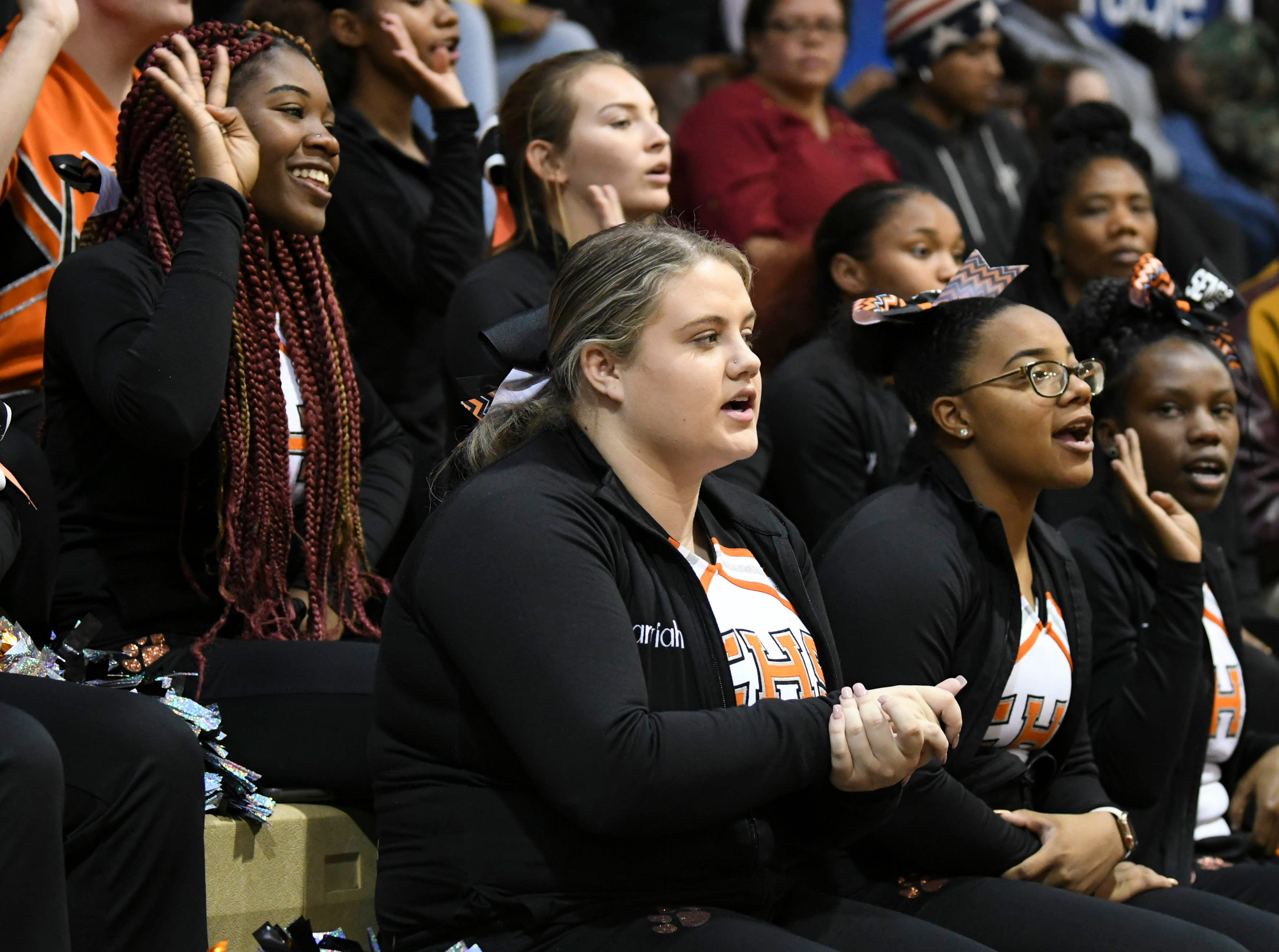 Cocoa High cheerleaders cheer for the Tigers during Tuesday's basketball game.